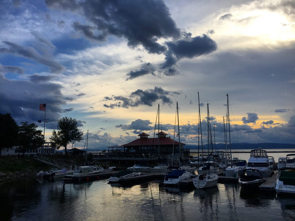 marina with boats on lake champlain
