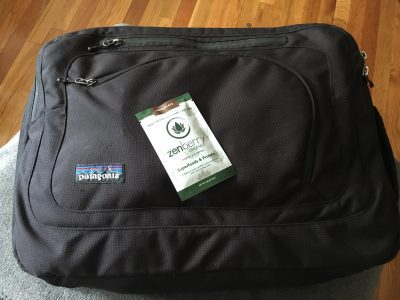 Zenberry packet on top of luggage