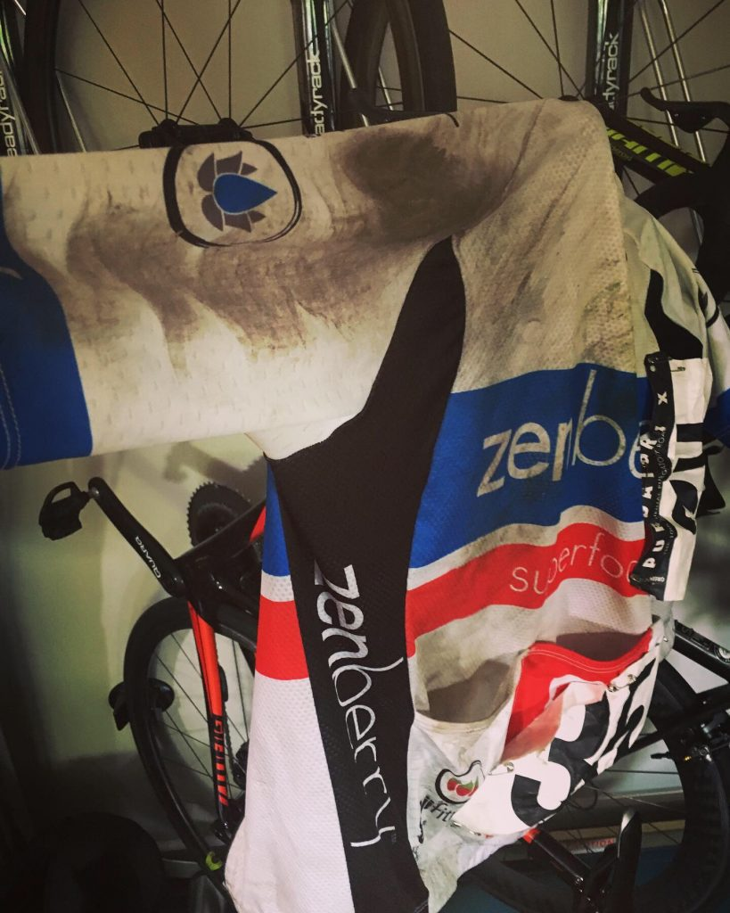 torn, dirty cycling jersey