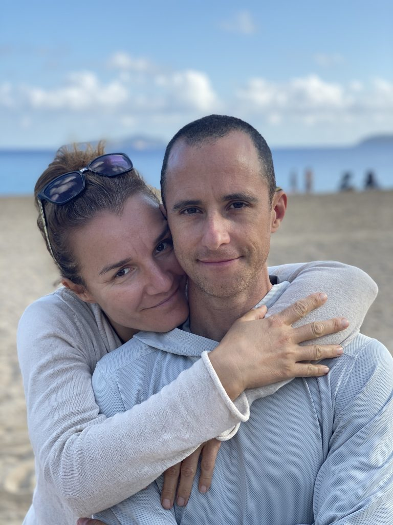 Man and woman hugging on a beach